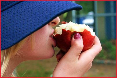Girl in Hat Eating an Apple